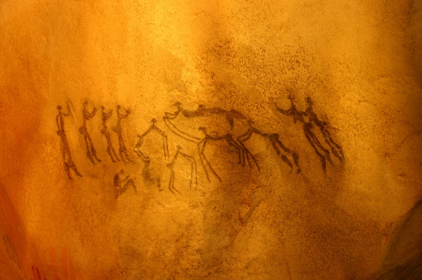 Image by Ryan Somma via Flickr (CC BY-SA 2.0). Cave painting, dance scene. Taken at the David H. Koch Hall of Human Origins at the Smithsonian Natural History Museum.